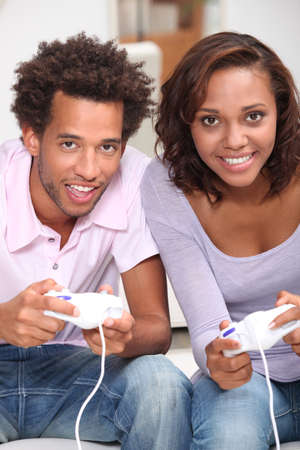Couple playing computer games Stock Photo - 11717601