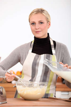 to incorporate: A woman mixing batter Stock Photo
