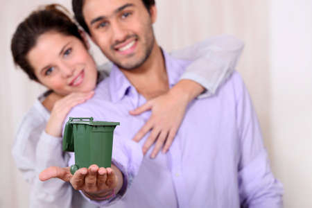 Man holding recycling bin photo
