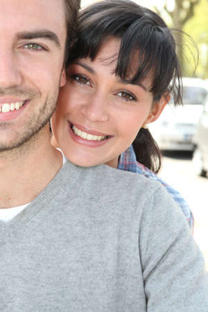 jaunty: tender couple hugging in the street Stock Photo