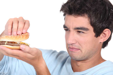 sicken: Man holding cheeseburger Stock Photo