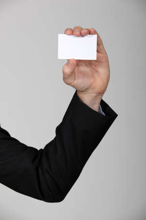 Holding up a business card photo