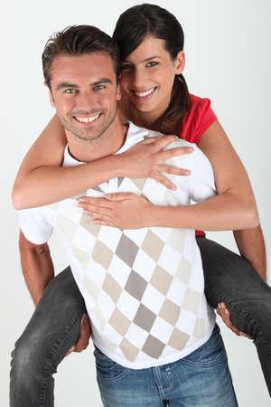 piggy back: Man giving girlfriend piggyback