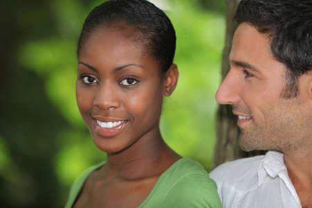 mixed couple: Man looking at his beautiful girlfriend Stock Photo