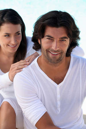 dark haired: Well matched dark haired couple in white summery clothes Stock Photo
