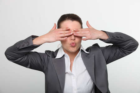 Female office worker covering eyes Stock Photo - 11138735