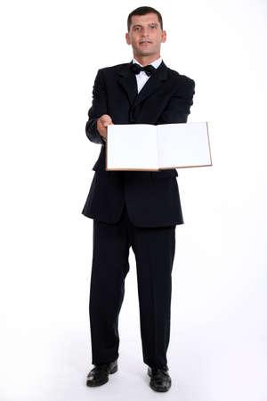Waitor holding book Stock Photo - 11050698