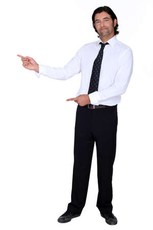 black tie: man in a suit pointing at something