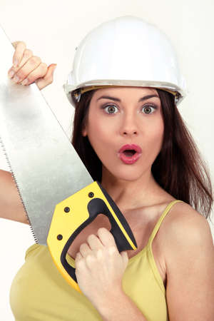 handsaw: Surprised woman with a handsaw