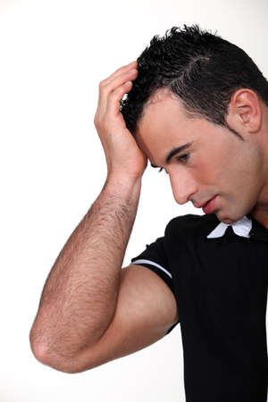 Man suffering from a throbbing headache Stock Photo - 11143715