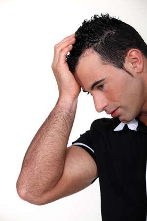 cephalgia: Man suffering from a throbbing headache