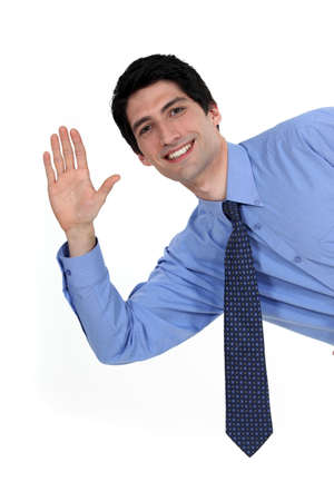 friendly people: A businessman waving.
