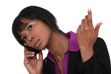Afro-American businesswoman talking on her cell photo