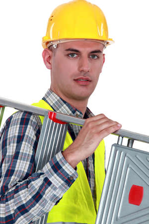 Man carrying ladder photo