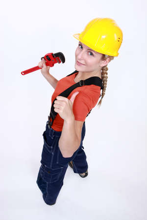 adjustable wrench: Tradeswoman giving the thumb