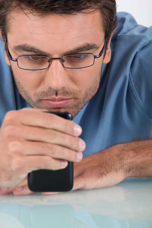 upset looking man with telephone Stock Photo - 11143730