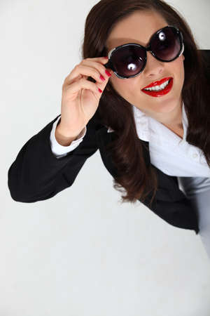 Brunette businesswoman wearing sunglasses photo