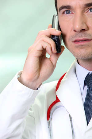 serious doctor: Serious doctor using a cellphone
