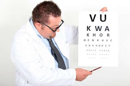 Eye doctor with an eye chart photo