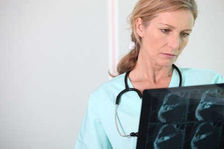 Nurse looking at X-ray Stock Photo