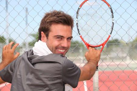 municipal court: Smiling male tennis player standing outside a municipal court Stock Photo
