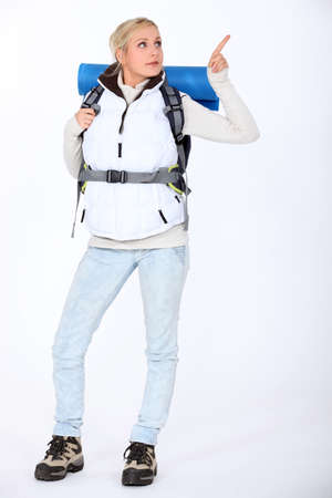 well equipped: Woman carrying hiking backpack Stock Photo