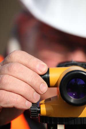 Civil engineer adjusting a theodolite