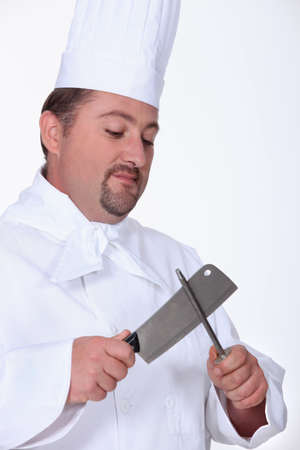 galley: Chef sharpening meat cleaver