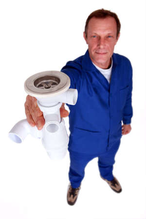 Plumber holding replacement sink plug Stock Photo - 11717632