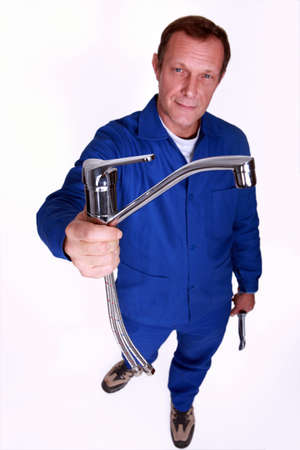 Plumber holding tap photo