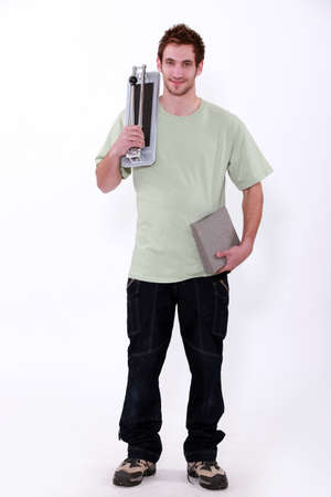 warehouseman: young man with small hand truck Stock Photo