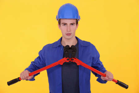 Young worker with bolt cutters Stock Photo - 11717718