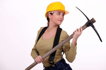Young woman holding pickaxe photo