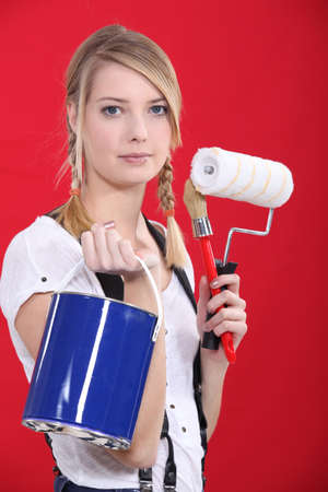 Painter holding her supplies Stock Photo - 11039312