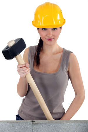 sexy construction worker: Young woman with a sledgehammer