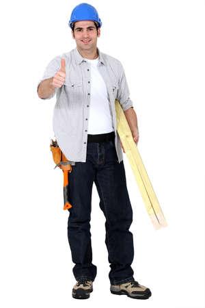 thumbsup: Carpenter giving thumbs-up