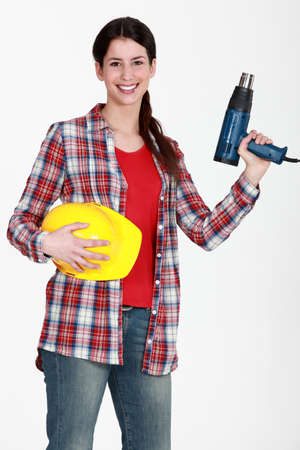 tradeswoman: Woman holding an electric screwdriver