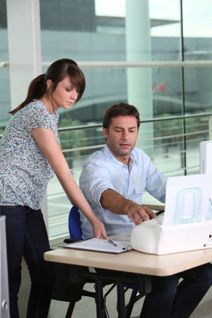 office printer: Printing with work experience student. Stock Photo