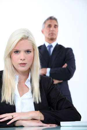overseen: Blonde businesswoman sitting in front of her boss
