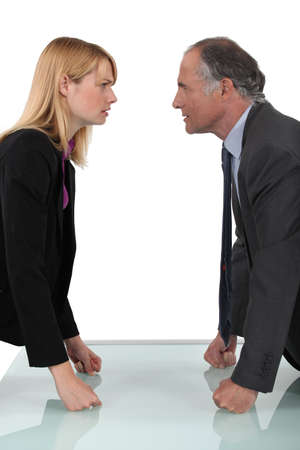 angry person: businessman and businesswoman having a quarrel