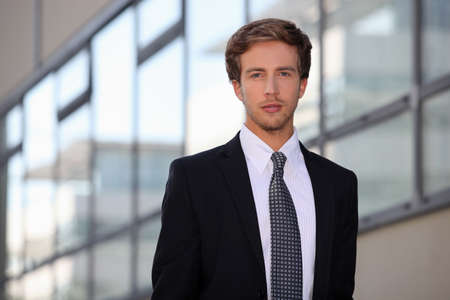 Young salesman in smart suit photo