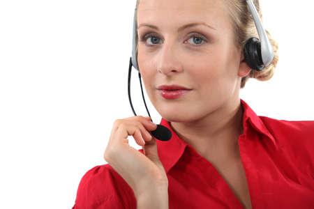 Woman wearing a telephone headset Stock Photo - 11717691