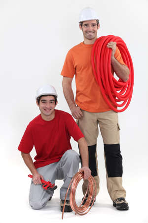 duo of cheerful plumbers Stock Photo - 11717774