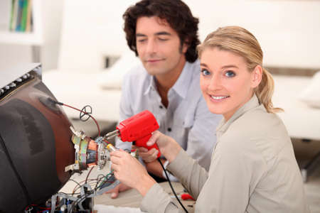 Woman soldering television photo