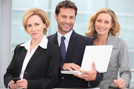 Trio of dynamic businesspeople photo