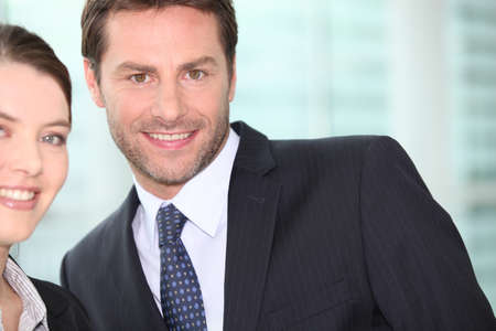 accomplices: businessman smiling with woman