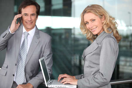 collaborators: Two executives working outside an office building Stock Photo