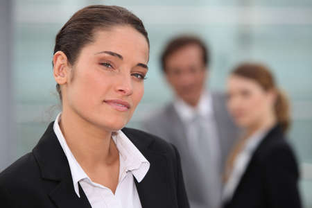 Businesswoman stood with colleagues in background Stock Photo - 11717734