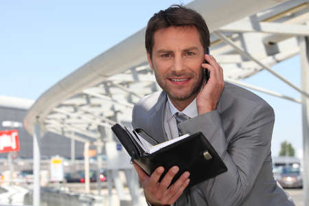 35 40 years: Businessman on phone with diary