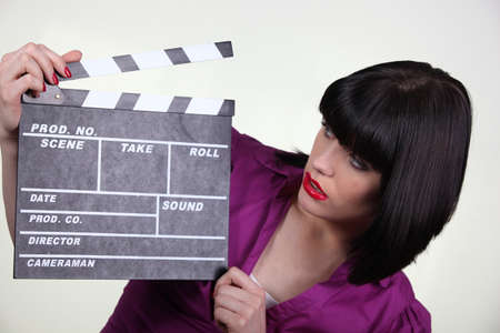 film shooting: brunette with clap Stock Photo